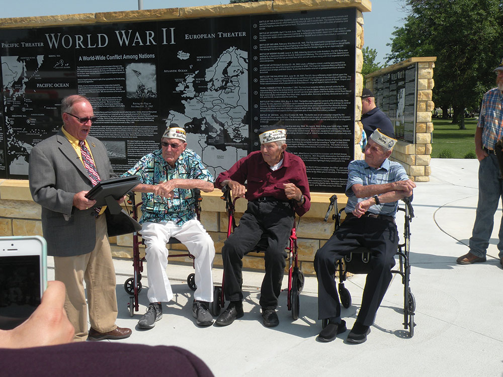 Merrick County Veterans Services Officer Gary Berry presents Pearl Harbor Survivors (from left) Earl Brandes, Lawrence Osterbuhr and Ed Guthrie with commemorative medals.