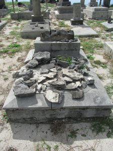 A grave marker in pieces