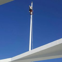 Volunteer Repairs Memorial Flagpole